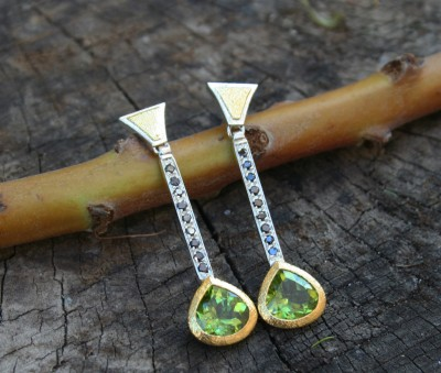 peridot and black diamond earrings in silver and rose gold